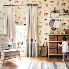 Two By Two Wallpaper An adorable children's wallpaper depicting pairs of naively drawn animals bound for Noah's Ark, printed in earthy tones on a beige background.