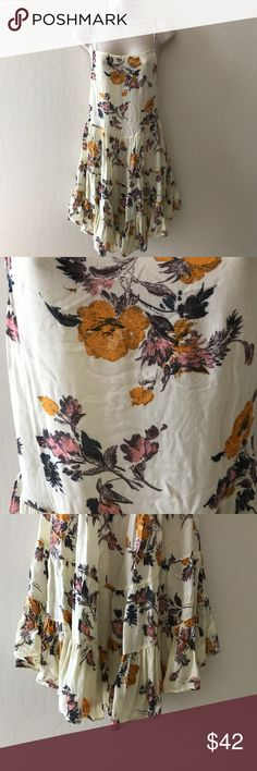 🖤SMALL INTIMATELY FREE PEOPLE SUN DRESS🖤 Beautiful floral print dress. Ties up in the back. Very very lightweight, almost sheer. Would need to wear a slip underneath. EUC. Approximate measurements- bust- 16 inches. Waist- 15 inches. Length- 39 inches. 100% rayon. Free People Dresses