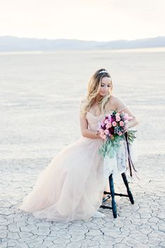 Pink wedding dress from Reem Acra | Kristen Joy Photography | see more on: http://burnettsboards.com/2015/01/dry-lake-bed-bridal-inspiration-shoot/
