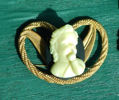 Neo-Victorian Faux Ivory Cherub, Angelic Putti  Brooch Pendant, with Brass Wings in Heart by emenow, $49.00