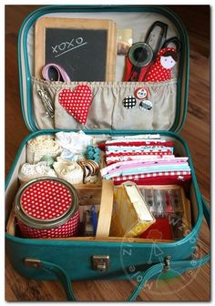 fabric and sewing supplies in a vintage suitcase