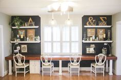 A beautiful chalkboard wall in this summer home tour. Love the long desk/counter idea, too!