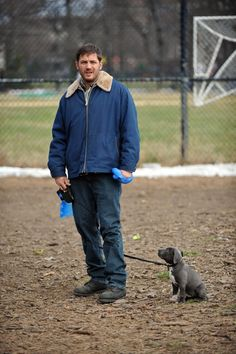 Pin for Later: Try Not to Smile at These Photos of Tom Hardy Holding Dogs