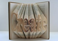 """Isaac Salazar takes a book, makes a lot of folds on the inside pages and out pops a typographic phrase like: 'dream', 'read', 'create', 'love' or f'aith'. He calls this series of work - Book Origami. Salazar explains his work: """"I see my work. Folded Book Art, Paper Book, Book Folding, Paper Folding, Paper Art, Cut Paper, Book Crafts, Paper Crafts, Recycled Books"""
