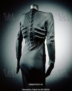 The Skeleton Dress, by Elsa Schiaparelli. 1938 the dress is so constricted that it became a second skin and the imitation anatomy sat  on the fine matt silk surface. Schiaparelli exaggerated the trapunto quilting technique to make enormous 'bones' - the design was stitched in outline through two layers of fabric, then cotton wadding inserted through the back to bring the design into relief on the front. The shoulder seams and right side are closed by bold plastic zips.