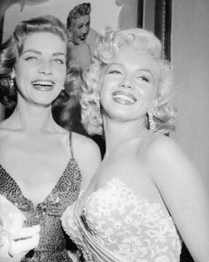Lauren Bacall and Marilyn Monroe at the premiere of 'How to Marry a Millionaire', 1953.