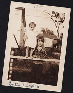 Old Antique Photograph Little Boy Holding Adorable Baby on Wood Railing 1931