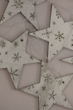 wood stars with snowflakes