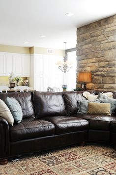 Cozy up your family room by creating comfortable nooks in your home with pillows and well placed lamps to curl up next to and read.  Don't just rely on overhead can lights.  Turning off the overhead lights and turning on a lamp will create warm soft light and make your home feel welcoming for family members and guests. Sponsored post.