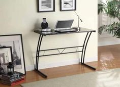 """Black finish metal and glass laptop computer desk with angled legs.  Measures 39"""" x 19.5"""" x 30"""" H.  Some assembly required."""