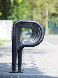BIKEPARK. The interesting visual moment with our bike rack Bikepark. It works worldwide with the intelligible meaning of the letter P. In this way, the shape smartly uses a purely functional solution. It is part of a whole system that was originally installed on car parking spaces in the streets. | mmcité street furniture |