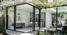 Killieser Avenue Project: sliding glass doors and frameless glass roof to rear extension in SW London Glass Extension, Rear Extension, Modern Patio Doors, Corner Door, Corner Windows, Sliding Door Window Treatments, Roof Lantern, Roof Light, Glass Roof