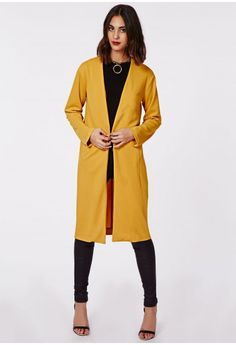 Collarless with a single button fastening, this mustard longline jacket is a great way to add vibrancy and a lush colour trend to your look. Add a 60's inspired shade to your new season wardrobe with our lush, mustard longline, stretch crep...