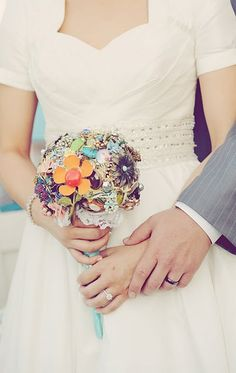 I'm already married, but had to repost becaus that is so cool!  Vintage Broach Bouquet
