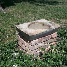 """Hypertufa birdbath on a base of """"Old Chicago"""" bricks."""