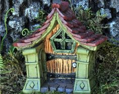 Fairy door that opens outlet cover casing. by NothinButWood