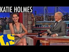 David Letterman helps Katie Holmes prepare to cook her first turkey.