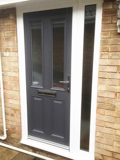 Altmore Composite door design, with simple clear glass, in a modern Anthracite Grey. Finished off with Rehau UPVC framework, with full length glass side panel. Front Door Canopy, House Front Door, Glass Front Door, Glass Door, Grey Composite Front Door, Black Front Doors, Grey Doors, Exterior Doors, Entry Doors