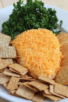 Easter Carrot Cheese Ball: Topped with a bundle of parsley, this cheesy appetizer is also a fun Easter decoration for your dinner table. Click through to find other easy Easter recipes for brunch, dinner, dessert, and more.