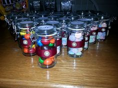 30th anniversary party favors. Jars filled with their favorite candies with a pearl on the bow for the 30th anniversary