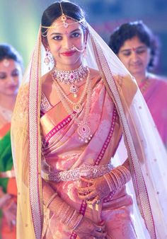 Romantic Bride in a Pale Pink Saree with Diamond Jewelry and Net Dupatta