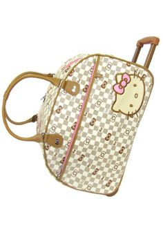 Bolso de equipaje Colección Kitty Grid.  Hello Kitty.  Precio: $ 114.60 (Sin I.V.A.)  Uso vertical (Con ruedas) y horizontal (bolso de hombro/mano)