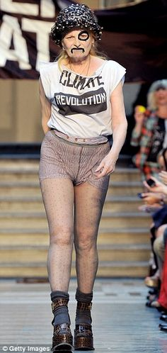 Vivienne Westwood took to the stage at London Fashion Week with black marker scribbled across her face, whilst donning tartan shorts and a climate revolution T-shirt
