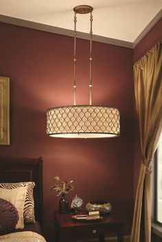 Drum Pendant with array of sunflower shape bauhinia crystals placed delicately in a burnished silver metal frame adds a glamourous touch to your home