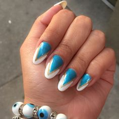 """#OverheardAtCNDOffices: """"My favorite part of this peacock-inspired mani is the crystal shine from the new SHELLAC™ Brand XPRESS5™ Top Coat!"""""""