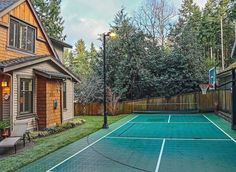 Here is another small space with a mixed sports court. By designing the area to accommodate two different sports, you are effectively making the most of the space. There is also a tall lamp to make this multiple use space great for both day and night sports.