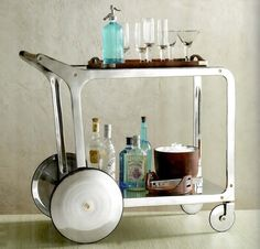 Have a party on wheels with a splash of style with this circa bar cart. This bar cart is made entirely of recycled cast and sheet aluminum with the West Elm, Table Mobile, Mobile Bar, Deco Paris, Tea Trolley, Tea Cart, Gold Bar Cart, Bar Cart Decor, How To Clean Metal