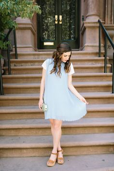 Pastel Blue Pleated Dress Keepsake The Label Louboutins & Love Fashion Blog Esther Santer NYC Street Style Blogger Outfit OOTD Pretty Photoshoot Upper East Side Dolce Vita Wedges Gold Jewelry Clutch Club Monaco White Women Tee Shirt Inspo Summer Look.jpg