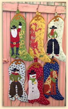 Cowboy Christmas Pattern:  6 different western Christmas stockings to decorate your western themed holiday home.  Pattern designed by Peggy Larsen and Laura Heine.