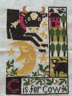 completed cross stitch Prairie Schooler C is for Cow sampler