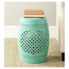 Waiting to find the perfect garden stool. Love this color and the quatrefoil.