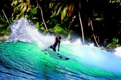 Surfing in beautiful clear water