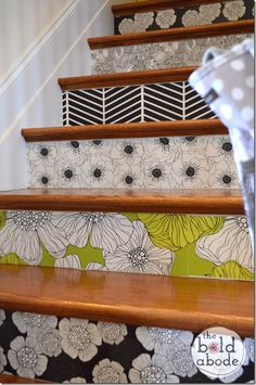 Wallpaper stairs for a fun and unique look! Use double stick tape so that you can change out and use holiday wrapping paper during the holidays!