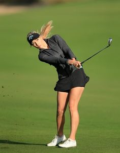 DUBAI, UNITED ARAB EMIRATES - DECEMBER 09: Paige Spiranac of United States plays her third shot at the par 5, 10th hole during the first round of the 2015 Omega Dubai Ladies Masters on the Majlis Course at The Emirates Golf Club on December 9, 2015 in Dubai, United Arab Emirates. (Photo by David Cannon/Getty Images)