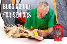 Senior man on vacation and reading by tent