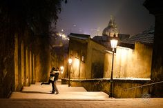 CLICK THIS PIN to see more night time romantic Prague Czech Republic photos.  Couples kiss at prague castle