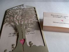 Close up of ornate love tree laser cut wedding invitation and reply card with both sides closed and reply card closed