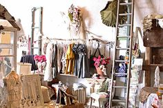 I like the idea of clothing displays hanging from the ceiling! Maybe use natural objects as displays (like the branches holding the clothes)