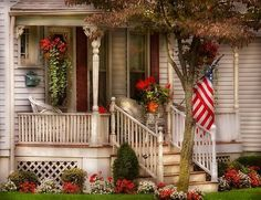 Americana Porch... reminds me of a Norman Rockwell painting... Lovely!