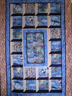 $10 Ocean Windows is a single bed quilt using attic window blocks.  This pattern is suitable for all sorts of feature prints, animals birds even flowers.