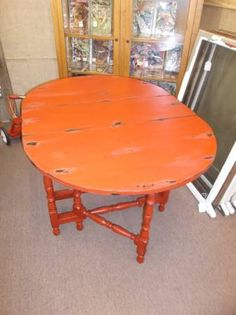 $225 - Shabby Chic Gateleg table - painted red, distressed, antiqued and finished in a dark wax. ***** In Booth E4 at Main Street Antique Mall 7260 E Main St (east of Power RD on MAIN STREET) Mesa Az 85207 **** Open 7 days a week 10:00AM-5:30PM **** Call for more information 480 924 1122 **** We Accept cash, debit, VISA, MasterCard or Discover.