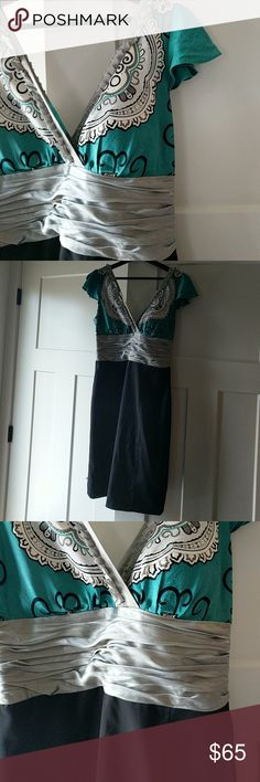 """Phobe couture silk bodice  cocktail dress 8 Beautiful silk teal and grey bodice.  Black polyester skirt, pleated at the hemline in the back.  A unique and elegant dress.  Fully lined.  Dry clean only.  30"""" from top of bodice to skirt bottom.  17"""" arm pit to arm pit.  Zips up the left side.  Built-in bra padded. Phobe Couture Dresses Midi"""