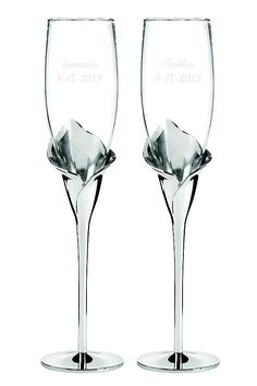 With silver-tone stems sculpted into calla lilies, these gleaming toasting flutes will make your wedding reception even more special! Flutes are 10 tall Silver-plated metal base with glass bowl Calla Lillies, Calla Lily, Lilies, Wedding Reception Food, Wedding Toasts, Wedding Favors, Wedding Cakes, Wedding Glasses, Champagne Glasses