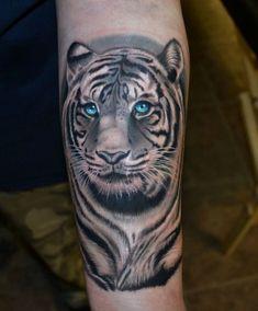 http://tattoo-ideas.us/wp-content/uploads/2013/08/Realistic-Tiger-Tattoo.jpg Realistic Tiger Tattoo