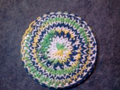 My newest idea.  A loom knit coaster using a cd or dvd in the center so the moisture will not seep through.  I used variegated cotton, but u...