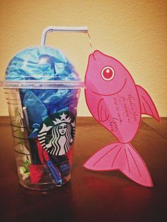 """Gift for swim teacher: throw a Starbucks gift card in an unused Starbucks drink container and stuff with candies and tissue paper. Add fish card. #swimteachergift #gift #swimming (thanks a """"latte"""" wording from Pinterest)"""